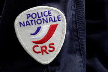 A badge of the Compagnies Republicaines de Securite (CRS), French riot police units, is pictured at the 20th Milipol Paris, the worldwide exhibition dedicated to homeland security, in Villepinte