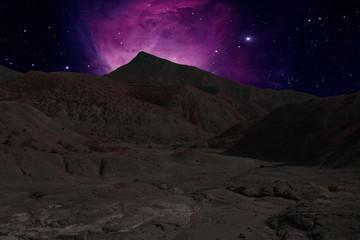 Mountains ridges on the background a nebula