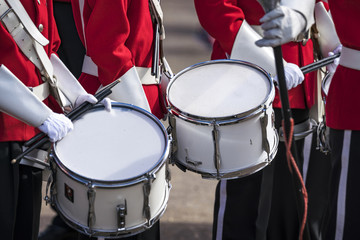 Soldiers in red uniforms with drums