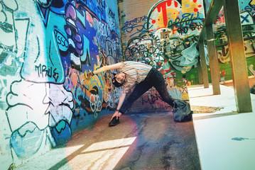 Girl dancing breakdance on the floor