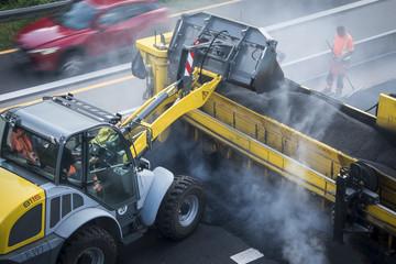 Construction site roadwork, new asphalt layer