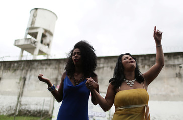 """Prisoners and participants of the """"TB Girl"""" beauty contest sing during an evangelical act at the end of the contest at the Talavera Bruce women prison in Rio de Janeiro"""
