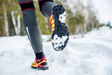Walking or running legs sport shoes, fitness and exercising in autumn or winter nature.