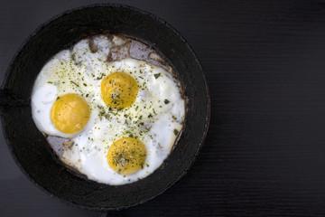Foto op Canvas Gebakken Eieren appetizing fried eggs in an old frying pan