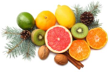 Christmas background. mix sliced lemon, green lime, orange, mandarin, kiwi fruit and grapefruit with cone and fir tree isolated on white background