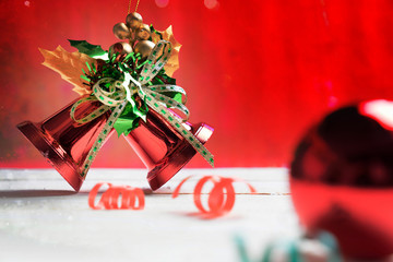 christmas bell on red bokeh background