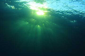 Underwater blue background and sunlight