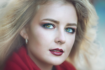 Blonde girl in glamorous close-up outdoor