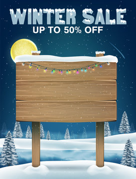 winter sale with wood board sign on winter lake