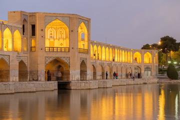Iranian are rest at Pol-e Khaju bridge, 132 meter  long over Zayande river , since 1500 years ago, Esfahan, Iran