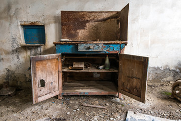 Old abandoned factory rooms, empty tool cabinet