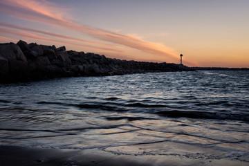 Jetty beach shoreline at golden hour