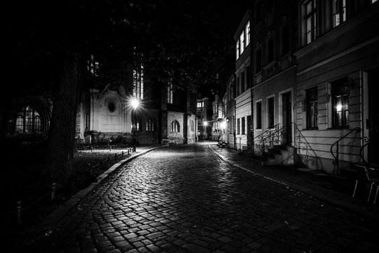 An ancient street in the historical quarter of Nikolaiviertel (Nicholas' Quarter). Berlin. Germany. Black and white.