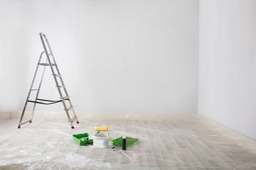 Painted White Room With Ladder And Painting Equipments