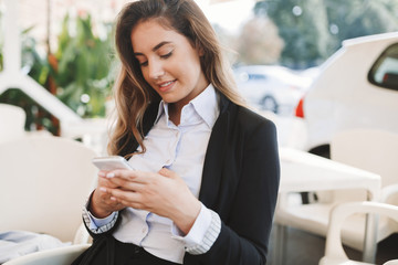 Beautiful woman using cellphone to text