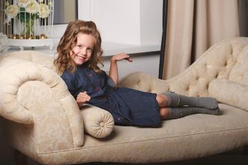 little funny girl posing on sofa