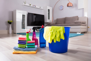 House Cleaning Products On Hardwood Floor