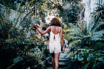 Back view of Afro American woman in tropical garden