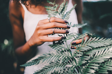 Close up of woman holding tropical leaf