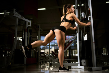 A girl trains in the gym.