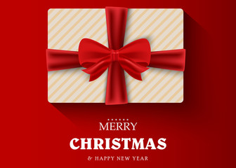 Gift on a red background with the wishes of Merry Christmas and Happy New Year. Greeting card or banner template. Vector illustration.