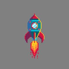 Pixel art spaceship rocket launch.