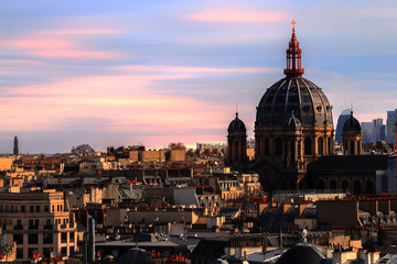 Paris church and residential roofs at the twilight moment listed in the Unesco world heritage site