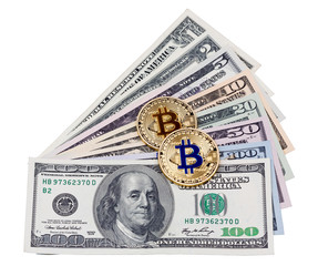 A few dollar banknotes with bitcoins on white background.
