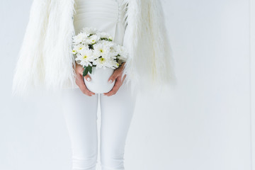 fashionable woman with white flowers