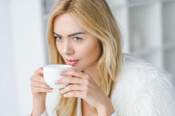 elegant woman drinking coffee