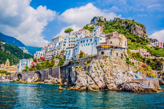The small haven of Amalfi village with the tiny beach and colorful houses, located on the rock, Amalfi coast, Italy.