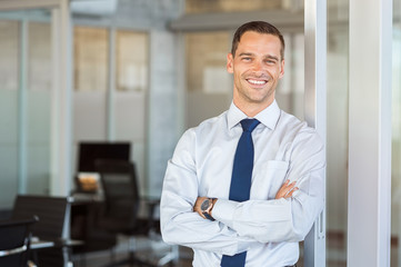 Smiling businessman at office