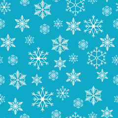 Snowflakes seamless pattern. Snow falls background. Vector illustration. Seamless pattern on a blue background