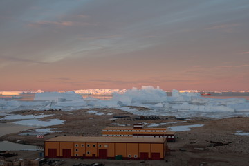 Progress station, Antarctica February 20, 2017: Panorama and just air. View of the ocean, icebergs and polar station, terrain and scenery Antarctic. Sunrise, Day, sunset. Shooting with quadrocopter.