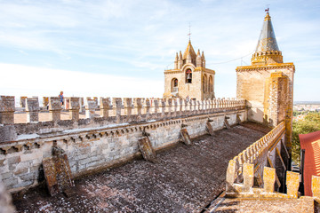 View on the terrace of the main cathedral with beautiful tower in Evora city in Portugal