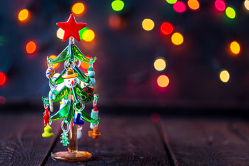 Glass Christmas Tree Toy on Blurred, Sparkling Background, Free Space for text, Christmas Wallpaper, New Year Mood