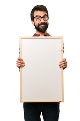Happy Man with glasses holding an empty placard
