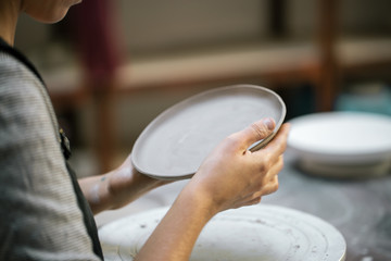 Crop artisan carving clay dish