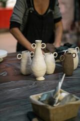 Artisan creating clay pots