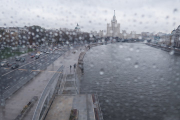 gray rainy moscow. View of the road and university