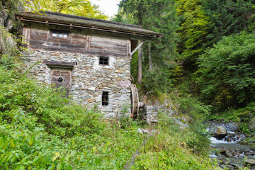 Old water mill in the forest thicket. Western Carinthia, Austria