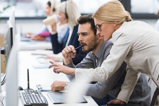 businesswoman helping colleague