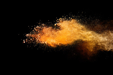 Freeze motion of colored powder explosions isolated on black background