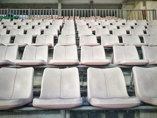 white seats grandstand in stadium for audience and fan club