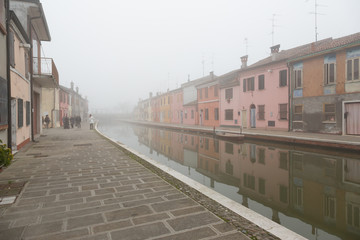 Comacchio (Italy) - Characteristic and fascinating historic town in the Park of the Po Delta, Comacchio has a maze of canals with small bridges and pastel-coloured houses.