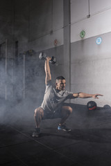 Muscular man workout with kettlebell