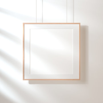 Square poster with wooden frame mockup hanging on the wall with shadows, 3d