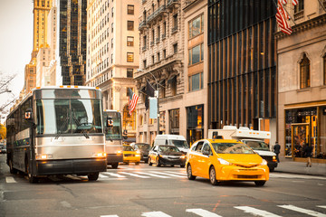 Poster New York TAXI Generic New York City street scene with taxi's buses, cars at intersection and unrecognizable people in typical upscale district