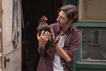 Man holding a hen