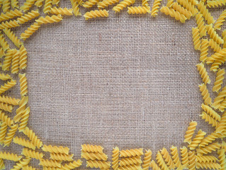 Pasta on a background of rough burlap.